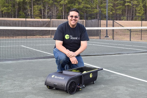 "Haitham Eletrabi on the tennis court, with his ""Tennibot"" robot"