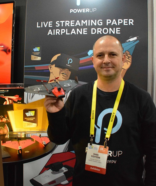 Shai Goitein with his PowerUp FPV paper airplane drone at CES' Eureka Park Marketplace.