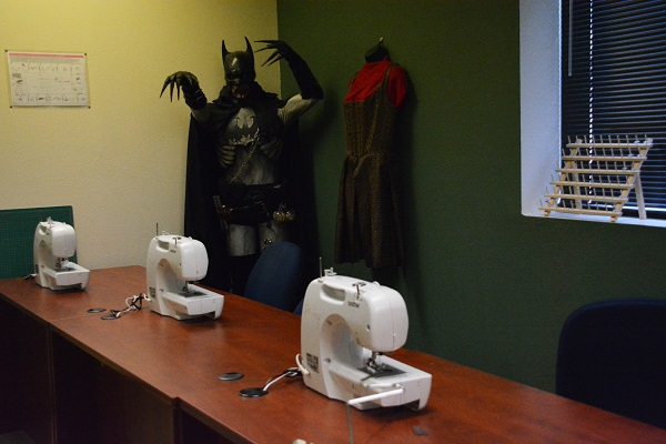 Batman costume near sewing machines