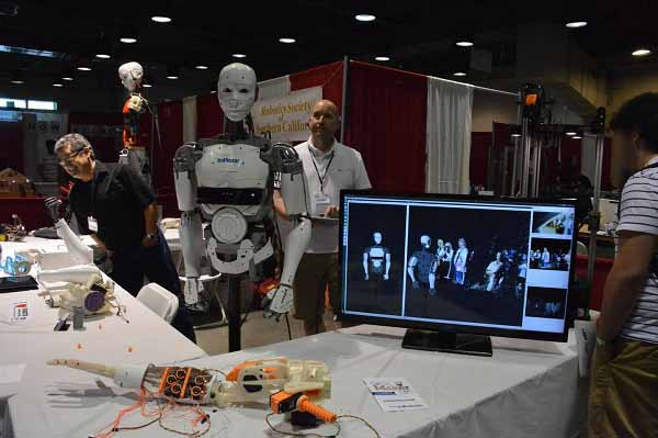 Mark Kranz and Alan Timm with InMoov robots at SoCal Maker Con.