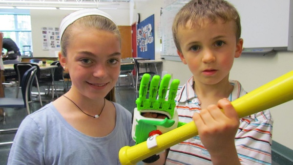 Max Lehrer with baseball grip device designed by student