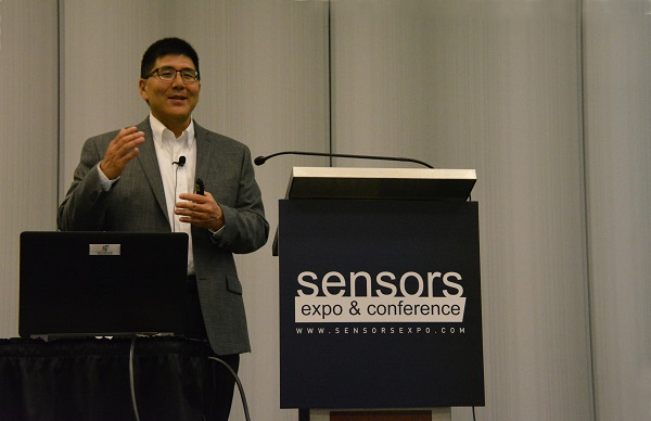DSP'S Will Tu smiles from SENSORS podium