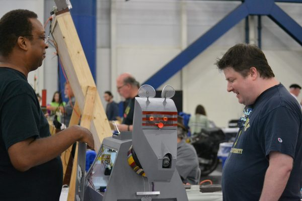 Man watches mahinery at work at Houston Maker Faire
