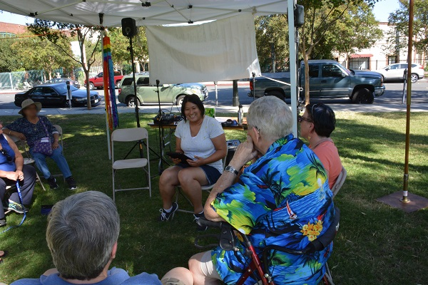 C.B. Lee reads to gathered audience at San gabriel Valley Pride Festival