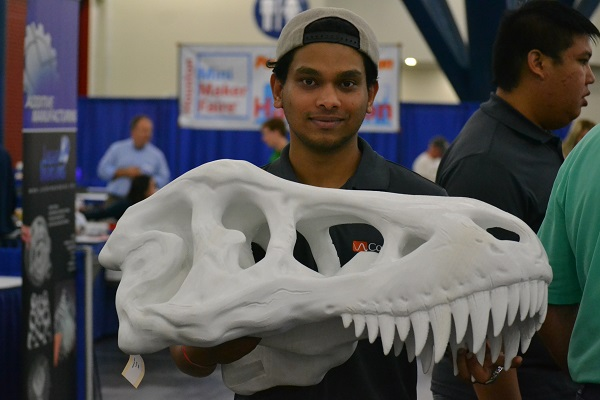 young man with 3D printed dinosaur skeleton head