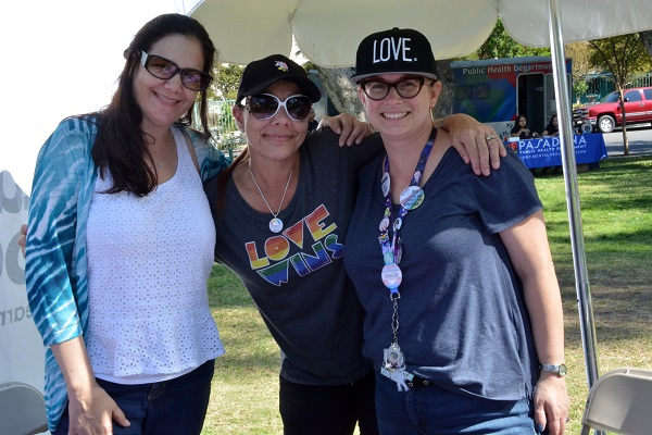 Three PFLAG staffers with their arms around each other