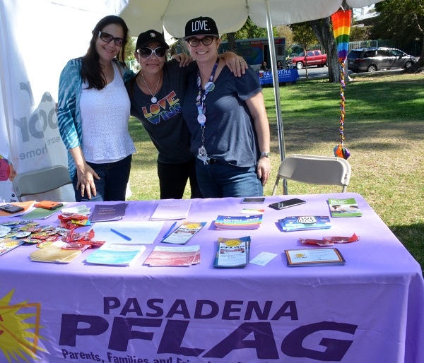 Pasadena PFLAG booth with three staffers