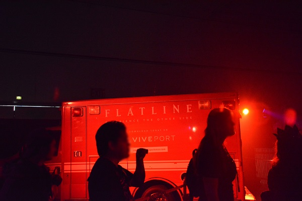 Visitors to Scare LA Halloween convention line up outside the Flatline Experience ambulance