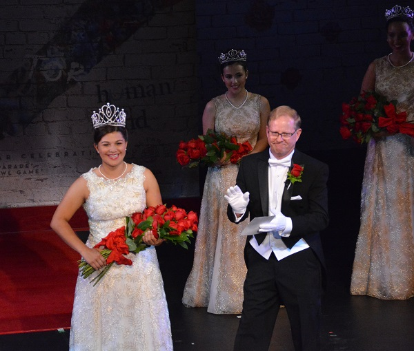 Tournament of Roses President Lance Tibbet applauds 100th Rose Queen Isabella Marie Marez after coronation