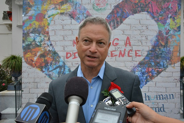 Gary Sinise talks to reporters