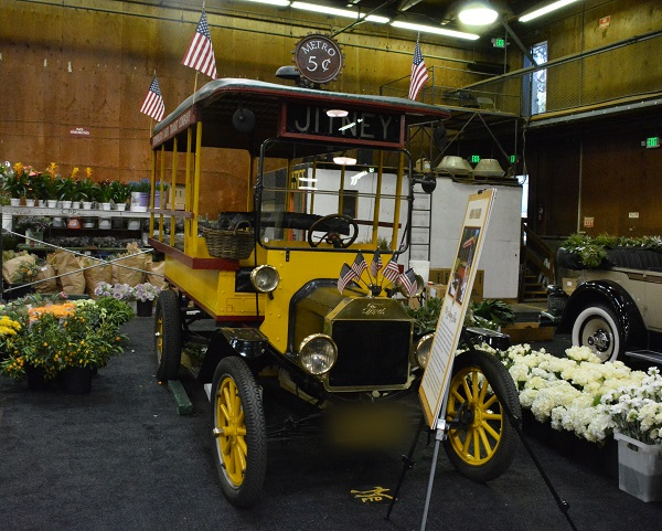 1924 yellow jitney surrounded by flowers