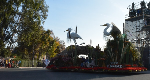 City of Torrance float turns onto Colorado Boulevard during 2018 Rose Parade