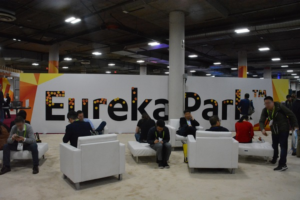 Eureka Park sign surrounded by CES 2018 attendees sitting in a lounge area