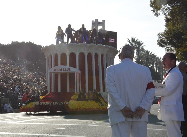Forum Club float appears with Earth Wind and Fire and backup singers aboard with White Suiters in foreground