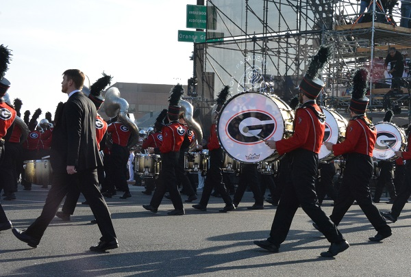 Georgia band in red and black uniforms marches in 129th Rose Parade at Orange Grove and Colorado Boulevards