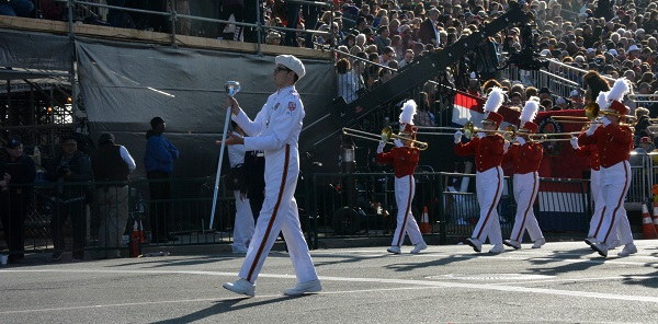 PCC band leader with baton leads Honor Band to Colorado Boulevard