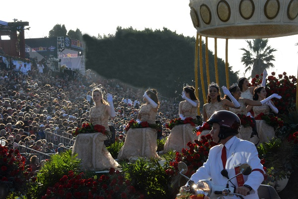 Rose Queen Isabella Marie Marez and her Royal Court wave to Rose Parade crowds