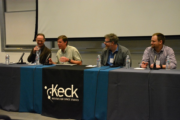 """Dr. Doug Bowman and three ellow fellow panelists seated at discussion panel dais with """"Keck Institute"""" banner"""