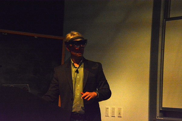 Parker Abercrombie wears a VR headset during his presentation