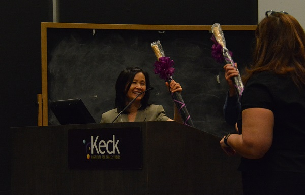 Emily Law recieves a gift-wrapped umbrella with a burgundy bow